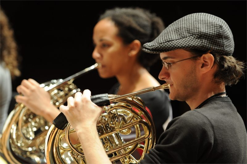 French horn players during an orchestra performance